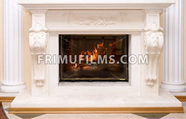 Burning fireplace as a piece of furniture - frimufilms.com