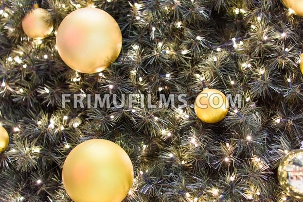 Golden ball toys on decorated christmas tree - frimufilms.com