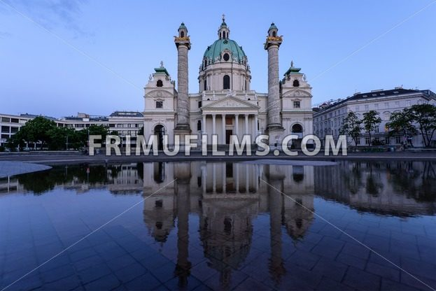 Karlskirche in Vienna Austria at sunset with reflection - frimufilms.com