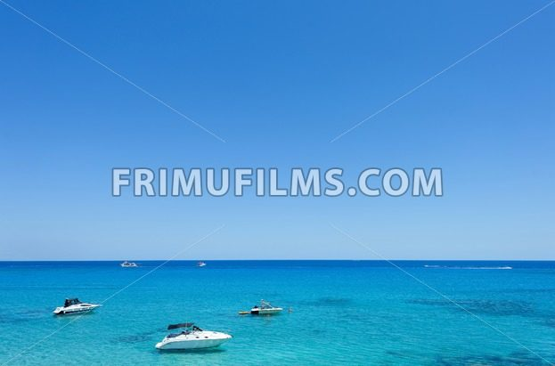 Photo of sea in protaras, cyprus island with boats and immaculate water - frimufilms.com
