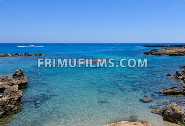 Photo of sea in protaras, cyprus island, with rocks and immaculate water. - frimufilms.com