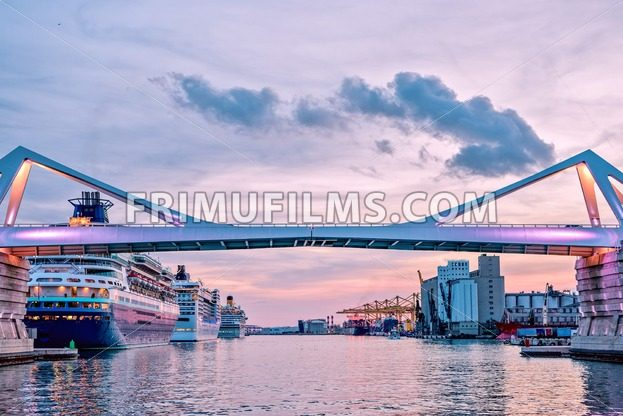 Stock Photo Europa Bridge at the entrance to Port Vell Barcelona, Catalunya Spain. Beautiful peaceful view sunset - frimufilms.com